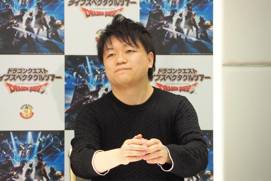 風間俊介とともに登壇した、プロデューサーの依田謙一