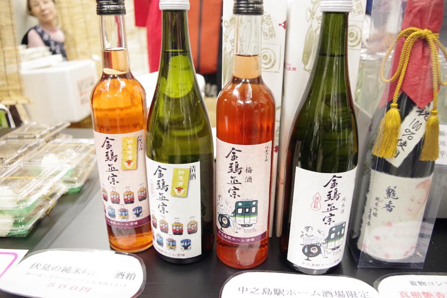 中之島駅ホーム酒場限定のオリジナル新ラベルの「キンシ正宗」純米酒と梅酒。6本セットには歴代特急ラベル1本入っているそう