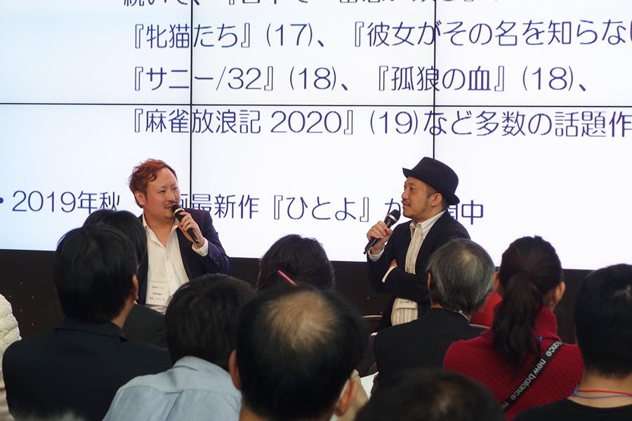 大勢の映画ファンが集った会場。白石和彌監督(右)と、映画評論家の田辺ユウキさんがトーク(5日・大阪市内)