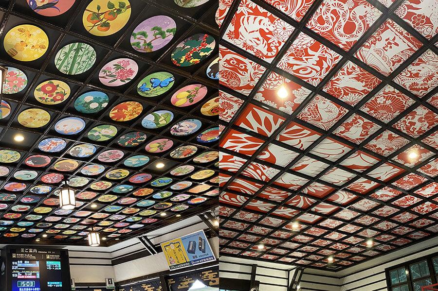 俗世(黒)と聖域(赤)を基調とした天井装飾が対照的なそれぞれのコンコース