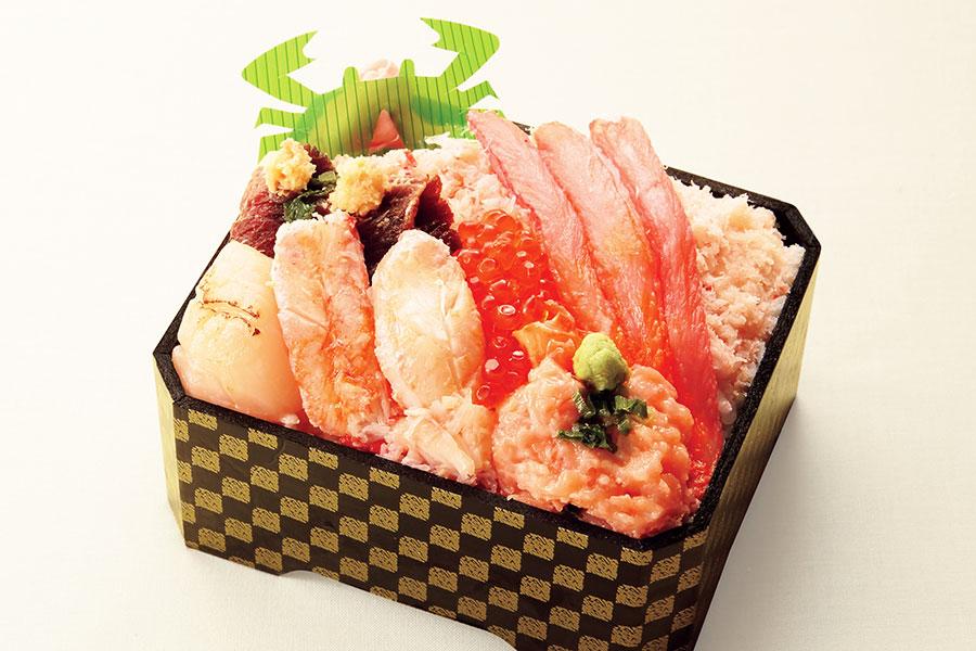 京都店で、9月30日から10月6日に登場する「札幌かに工房」の道産彩り食べ比べ弁当2700円(各日50食限定)