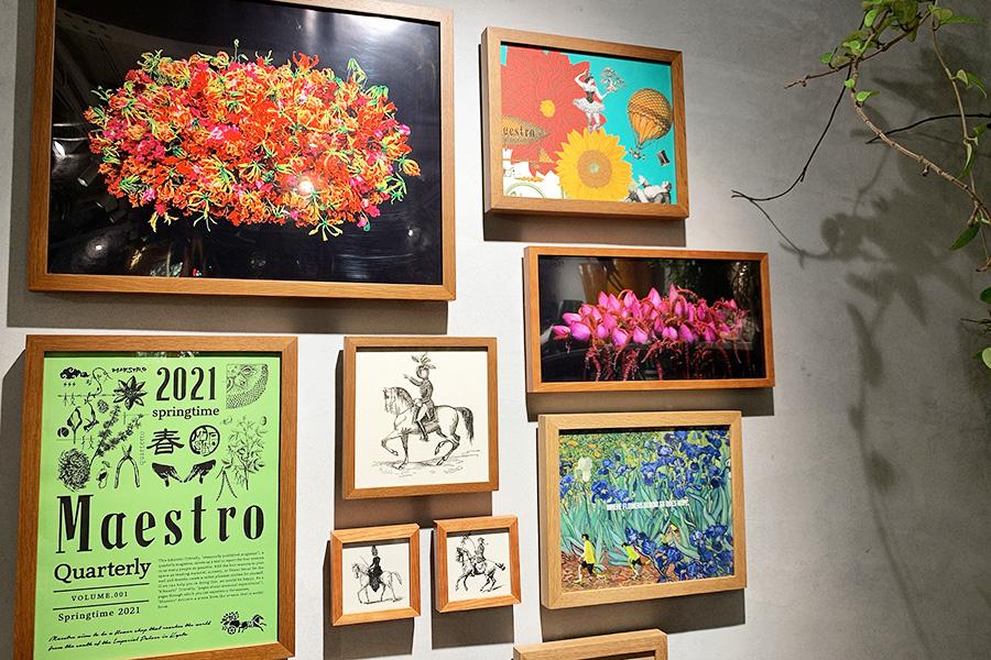 壁には主宰・綛谷さんの作品写真やアーチストのペインティングをコラージュ